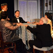 Cast of Blithe Spirit sitting around table