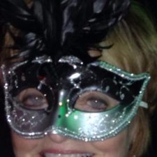 Ginny Racette with masquerade mask smiling