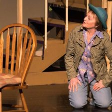Ginny Racette acting on stage during a performance of On Golden Pond
